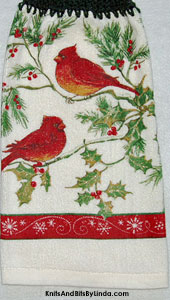 pair of cardinals on holly and pine branches hanging kitchen hand towel