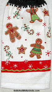 gingerbread boy and girl cookies on hanging kitchen hand towel