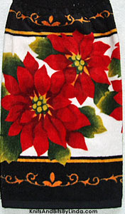 Christmas poinsettias on black background hand towel