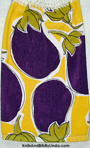 large eggplant on hanging kitchen hand towel