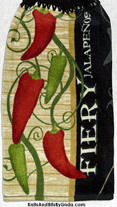 jalapenos peppers on hanging kitchen hand towel
