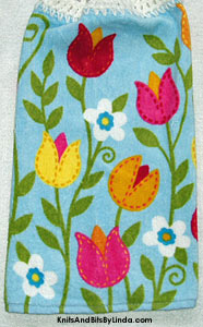 spring tulips on blue background towel