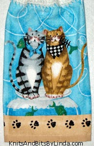two cats on hanging kitchen hand towel
